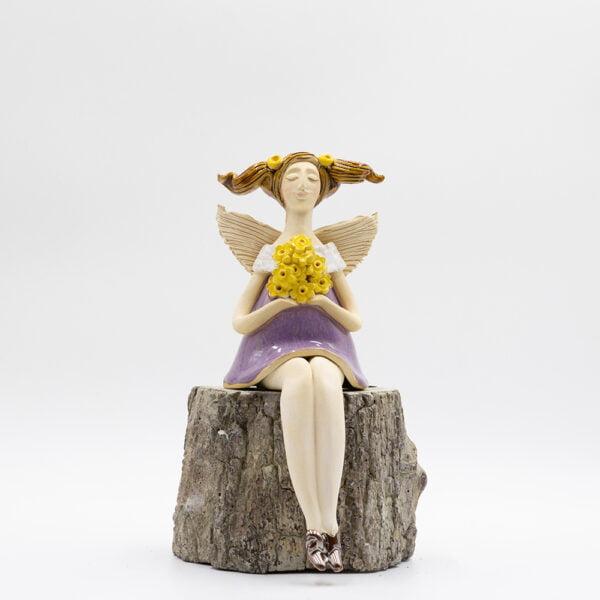 anioł z długimi nogami