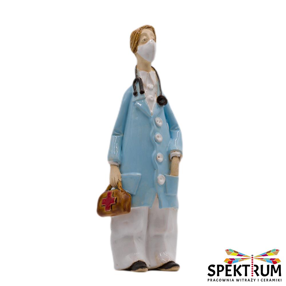 Lekarz z torbą lekarską w masce