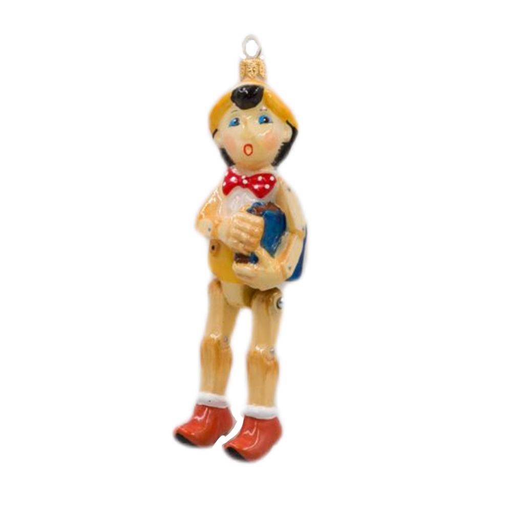 Bombka Pinokio z książką, z dyndającymi nogami
